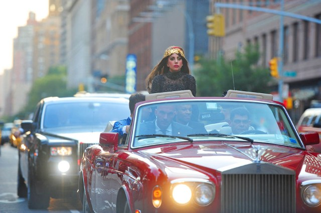 Extravagant Lady Gaga rides in top of the red convertible Rolls-Royce through New York Pictured: Lady Gaga Ref: SPL436459 130912 NON-EXCLUSIVE Picture by: SplashNews.com Splash News and Pictures USA: +1 310-525-5808 London: +44 (0)20 8126 1009 Berlin: +49 175 3764 166 photodesk@splashnews.com World Rights