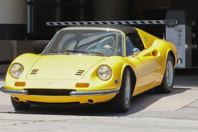 *EXCLUSIVE* Los Angeles, CA - Los Angeles - Harry Styles is spotted leaving a garage in an impressive classic Ferrari Dino. Harry immediately put his sunnies on as he drove off but the bright yellow ride is sure to attract attention anywhere he goes. Harry, a big car enthusiast, is reportedly the owner of a large fleet of sports cars which include a $200k Ferrari convertible, A Porsche 911 Sport Classic, A Jaguar E-Type Roadster, A classic Mercedes Benz, A range Rover Sport, an Audi R8 Coupe and a Ford Capri 1970. Not bad for 24! *SHOT ON July 12, 2018* Pictured: Harry Styles BACKGRID USA 14 JULY 2018 USA: +1 310 798 9111 / usasales@backgrid.com UK: +44 208 344 2007 / uksales@backgrid.com *UK Clients - Pictures Containing Children Please Pixelate Face Prior To Publication*