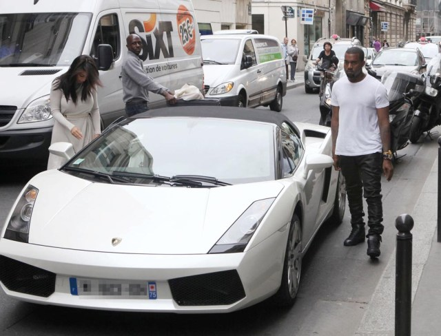 Kim Kardashian and Kanye West get into a white Lamborghini Kanye West and Kim Kardashian shopping in Paris, France - 19 Jun 2012 Kanye West and Kim Kardashian go to Othello accessory shop