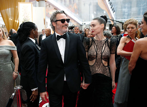 Joaquin Phoenix Wraps An Arm Around Rooney Mara As Couple Makes Rare Outing Together
