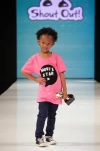 A future star struts down the runway with her award.