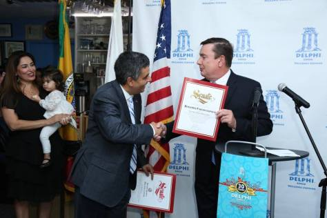 Senator Anderson presents Roozbeh Farahanipour with his commendation