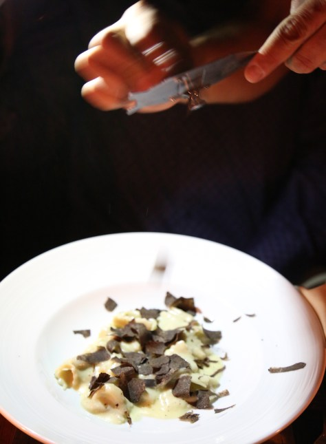 Chef Mure shaving mouth watering truffles on to a plate of handcrafted mushroom ravioli