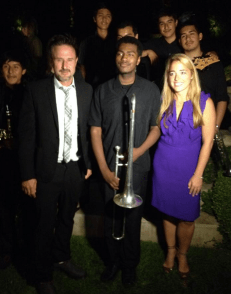 Michelle with actor David Arquette with Centennial High School in Compton's symphony orchestra at the one year anniversary of the Music Unites' program