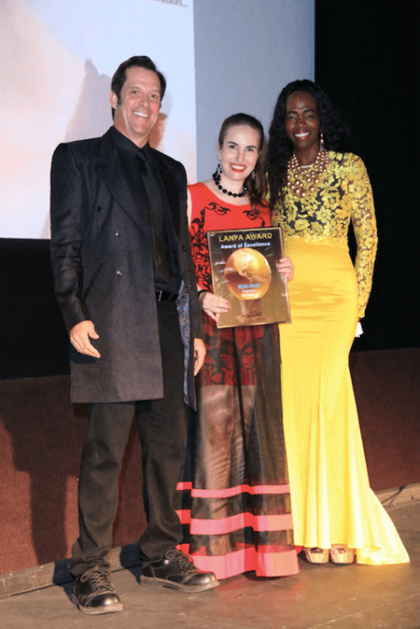 Awardee Vida with her award and presenters Ford Austin and Laverne Tillis