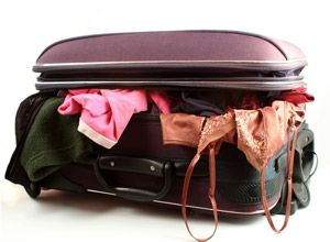 Image result for OVERFLOWING SUITCASE