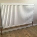 plumber installing radiators