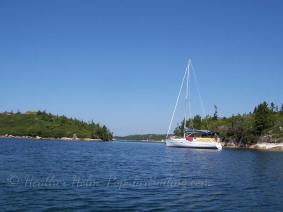 Our much-missed Beneteau Oceanis 323, anchored alone.