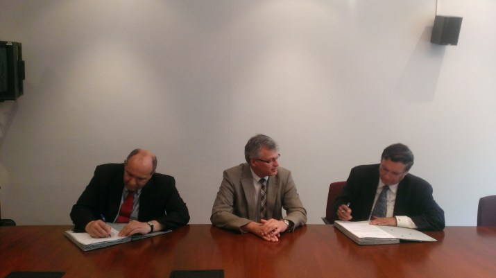 (from left to right) Mr. Robert Leclere, Synatom Chief Executive Officer; Mr. Wim de Clercq, Synatom Chairman; and Dr. Kris Singh, Holtec President and CEO, during the June 7th contract signing in Brussels