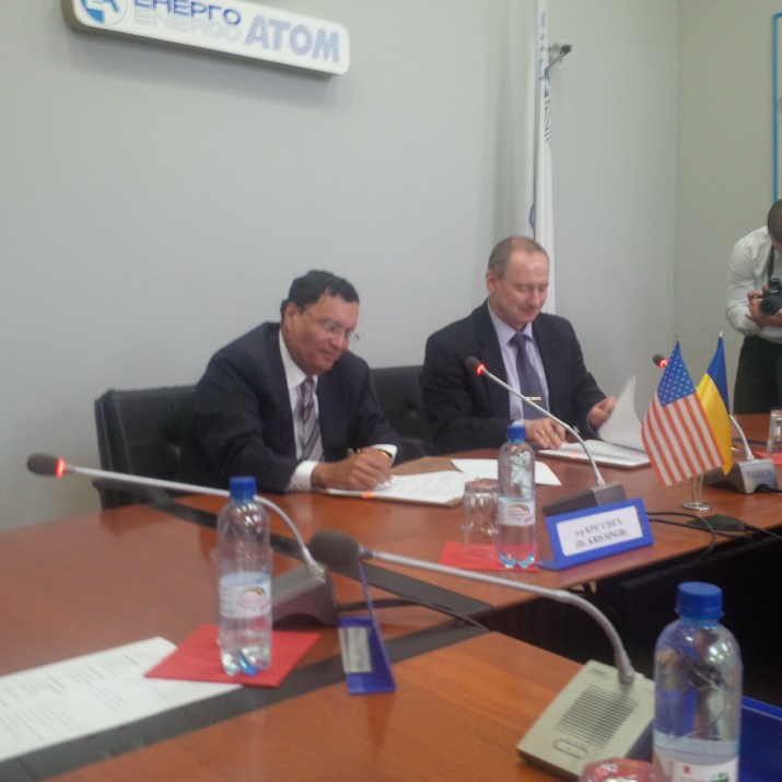 Dr. Singh (left) and Mr. Nedaskovsky (right) ink the agreement in Kiev on June 24, 2014
