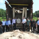 The Holtec Test Team Accompanied By Test Witnesses From Axpo, ENSI and SVTI with the Post‐Test HI‐STAR 180 Lying In The Catch Bin