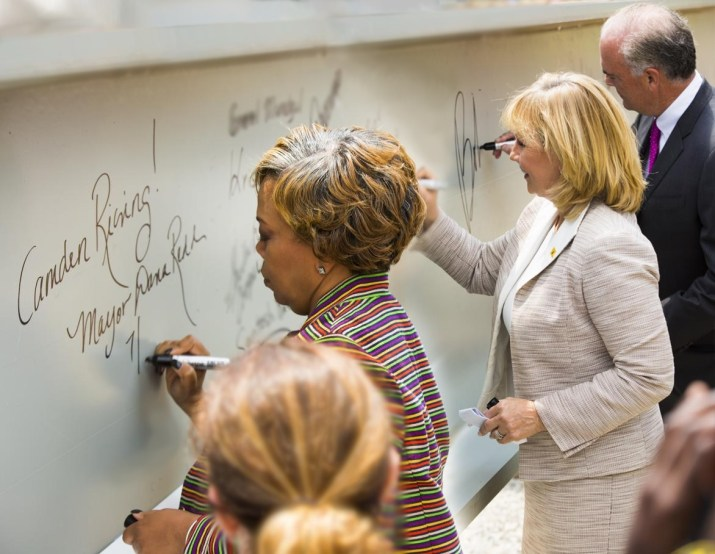 Camden Mayor Dana Redd (Left), Lt. Governor Kim Guadgano (Center) and NJ DEP Commissioner Bob Martin (Right) Signing the Ceremonial Steel Girder
