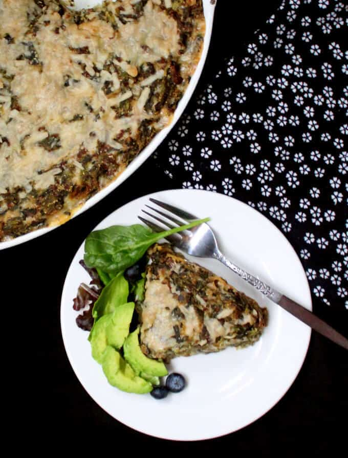 A Vegan Sausage and Grits Quiche is good eats for breakfast, brunch, lunch or dinner. Packed with protein from the vegan sausage, with leeks and spinach infused in every bite, this delicious take on a southern classic will make you want to eat until every last bit is happily tucked away in your tummy. #vegan #southernvegan #quiche #casserole #onepot #breakfast #brunch #lunch #dinner HolyCowVegan.net