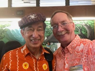 Rev. Choo Lak Yeow with Pastor Eric, both wearing orange shirts.