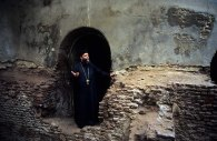 Photo: Norbert Schiller, a preist steps out of the ninth century church at the Convent of St. Dimyana.