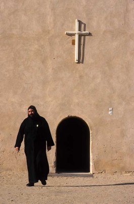 Photo: Norbert Schiller, a monk near the old wall of Dayr Anba Bishoi.