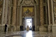 Pope Francis enters St. Peter's Basilica after opening the Holy Door, at the Vatican, Tuesday, Dec. 8, 2015. Pope Francis pushed open the great bronze doors of St. Peter's Basilica on Tuesday to launch his Holy Year of Mercy, declaring that mercy trumps moralizing in his Catholic Church.