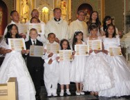 First Communicants from the 9:00 am Mass with their cetificates