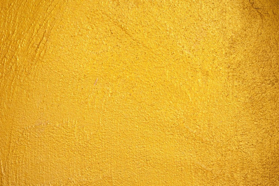 yellow paint texture on a stucco wall