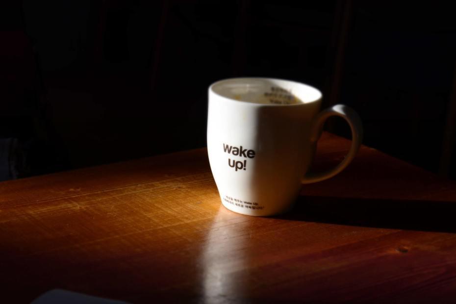 "photo of a coffee mug that says ""wake up!"""