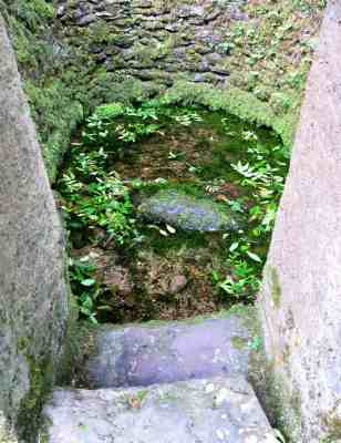 Steep steps lead down to the well
