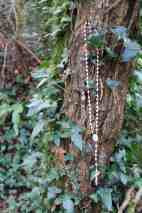 A pink rosary in the trees