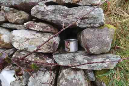 Tin cup tucked into wall