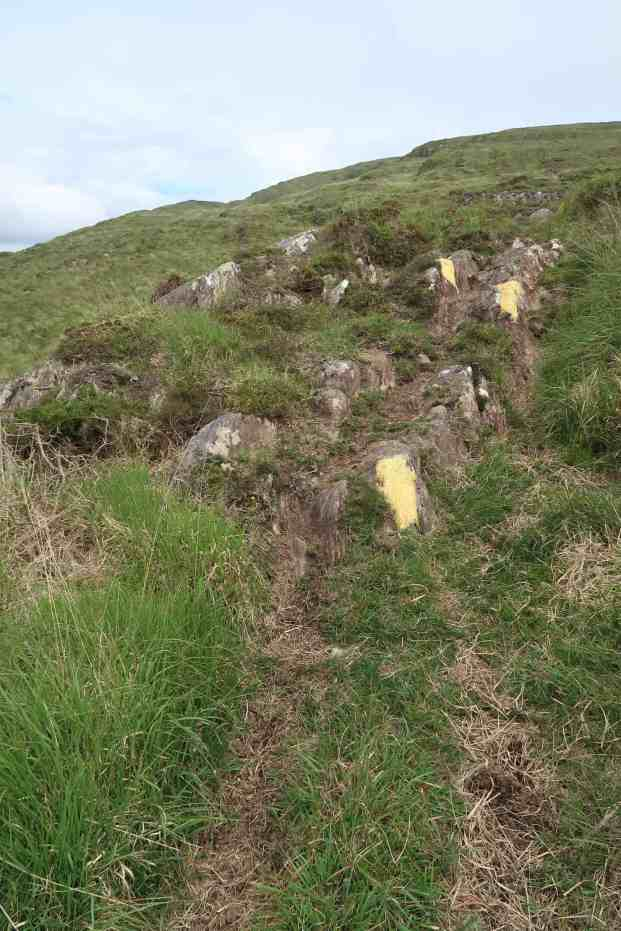 The route is marked by yellow daubs on the rocks