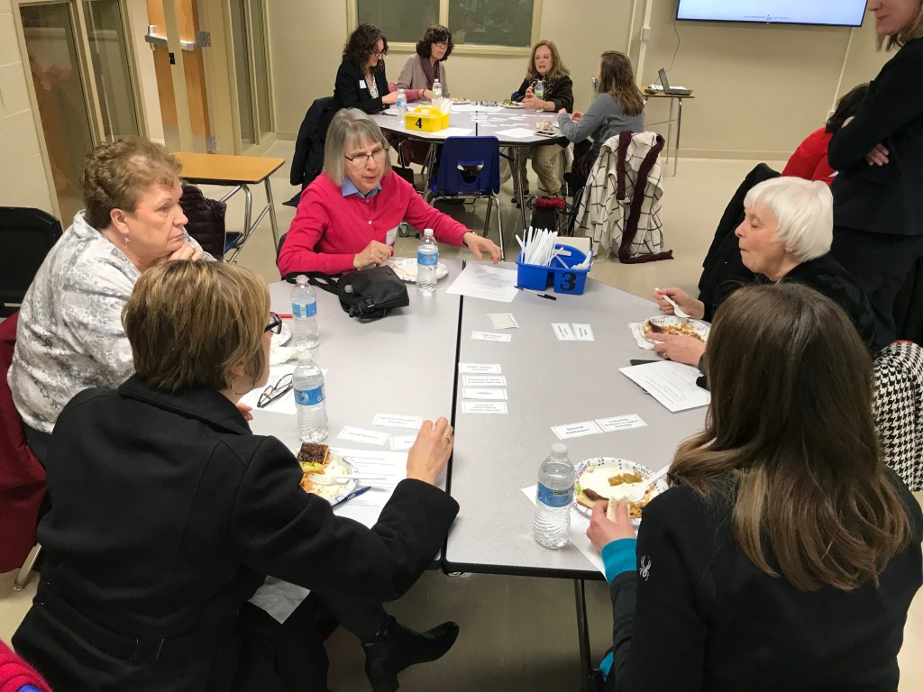 Photo of participants of Citizens Academy working on a problem