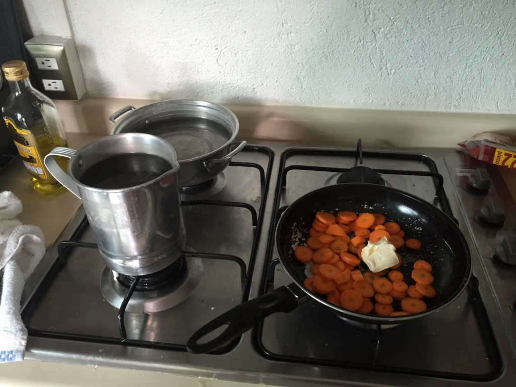 The two pots we use to warm water at a meal. Plus the sauteing carrots from breakfast this morning