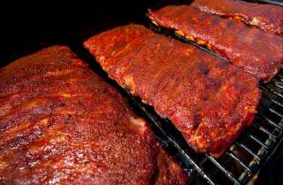 close up of ribs in smoker