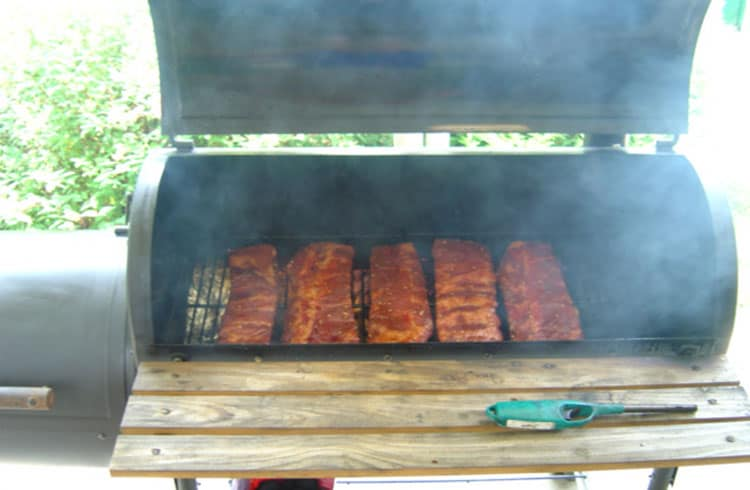 ribs in a smoker with phil's rib rub