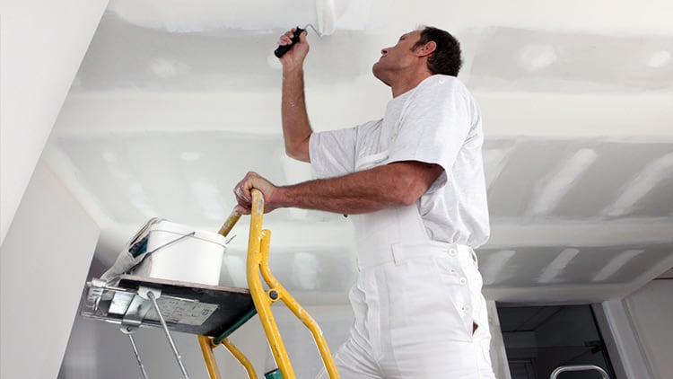 Painting a ceiling with a roller