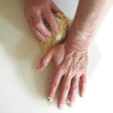 kneading dough by hand