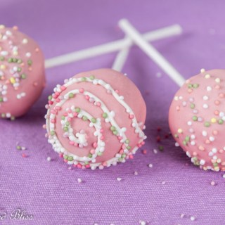 Chocolate cake pops with pink coating and colorful sprinkles!