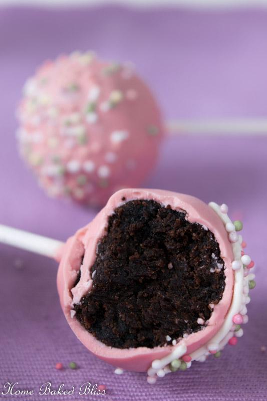 A half eaten chocolate cake pop.