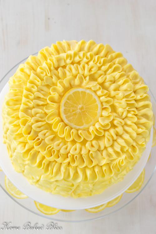Lemon ruffle cake garnished with a fresh lemon slice.