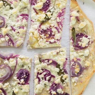 Tarte flambée with cream cheese, onions and feta