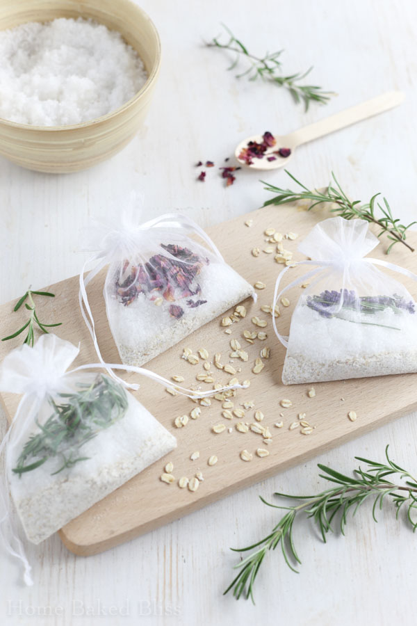 Tub tea sachets on a white background next to a bowl of salt and fresh sprigs of rosemary.
