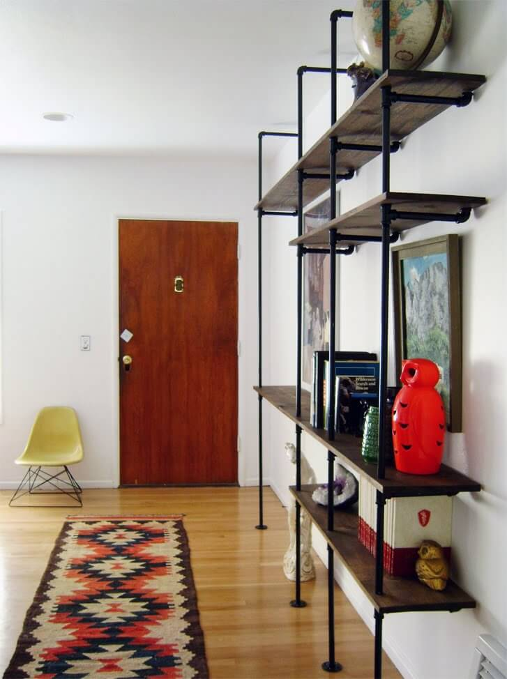 Gorgeous Floor-to-Ceiling Dimensional Pipe Shelving Display