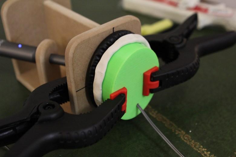 Testing plasticine sealing around cushion to headphone interface