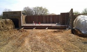 walkout foundation, concrete frost wall, form-a-drain tile, foundation tile, concrete brick ledge, poured concrete basement