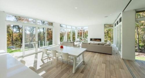 Lavish-Open-Floor-Interior-With-Wooden-Flooring-In-Bright-Interior-For-Modern-House-Magazine-On-Hardwood-Floor-With-Sun-Illuminate-936x531