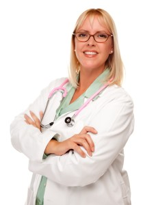 Friendly Female Blonde Doctor or Nurse Isolated on a White Background.