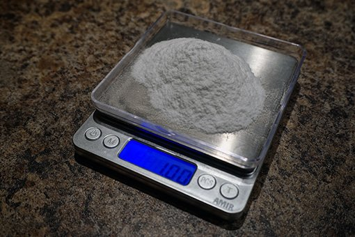 a digital scale with sugar on it to being measured for back sweetening hard cider