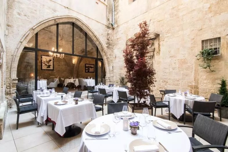 luxury restaurant outdoor patio courtyard stone wall france