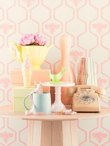collection of pastel homewares against pink wallpaper