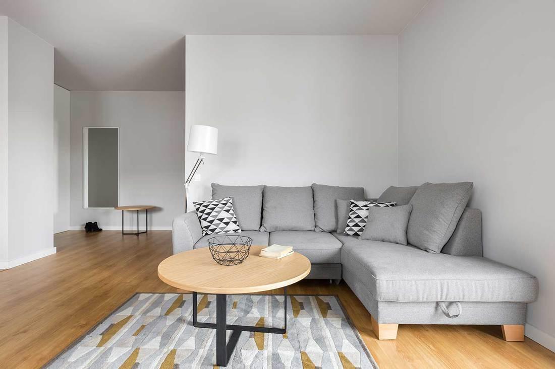a rug under a sectional sofa