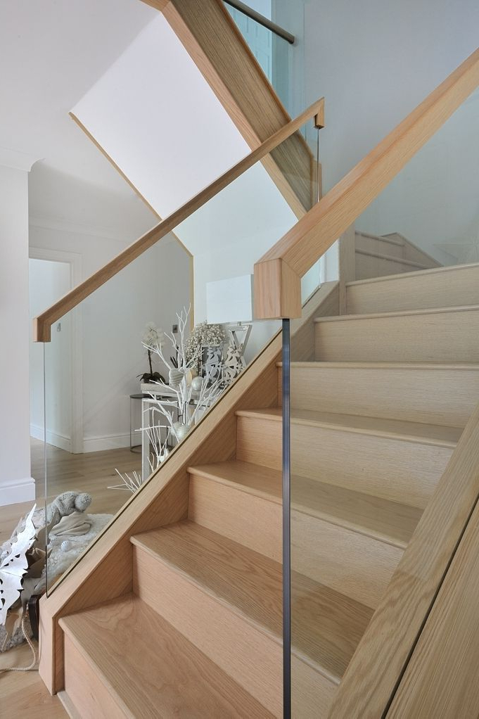 A Contemporary Oak And Glass Staircase With A Galleried