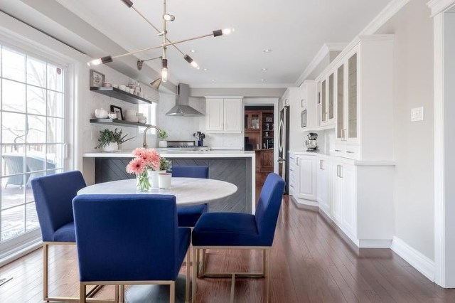Cobalt Blue Dining Chairs Surround A Round White Marble